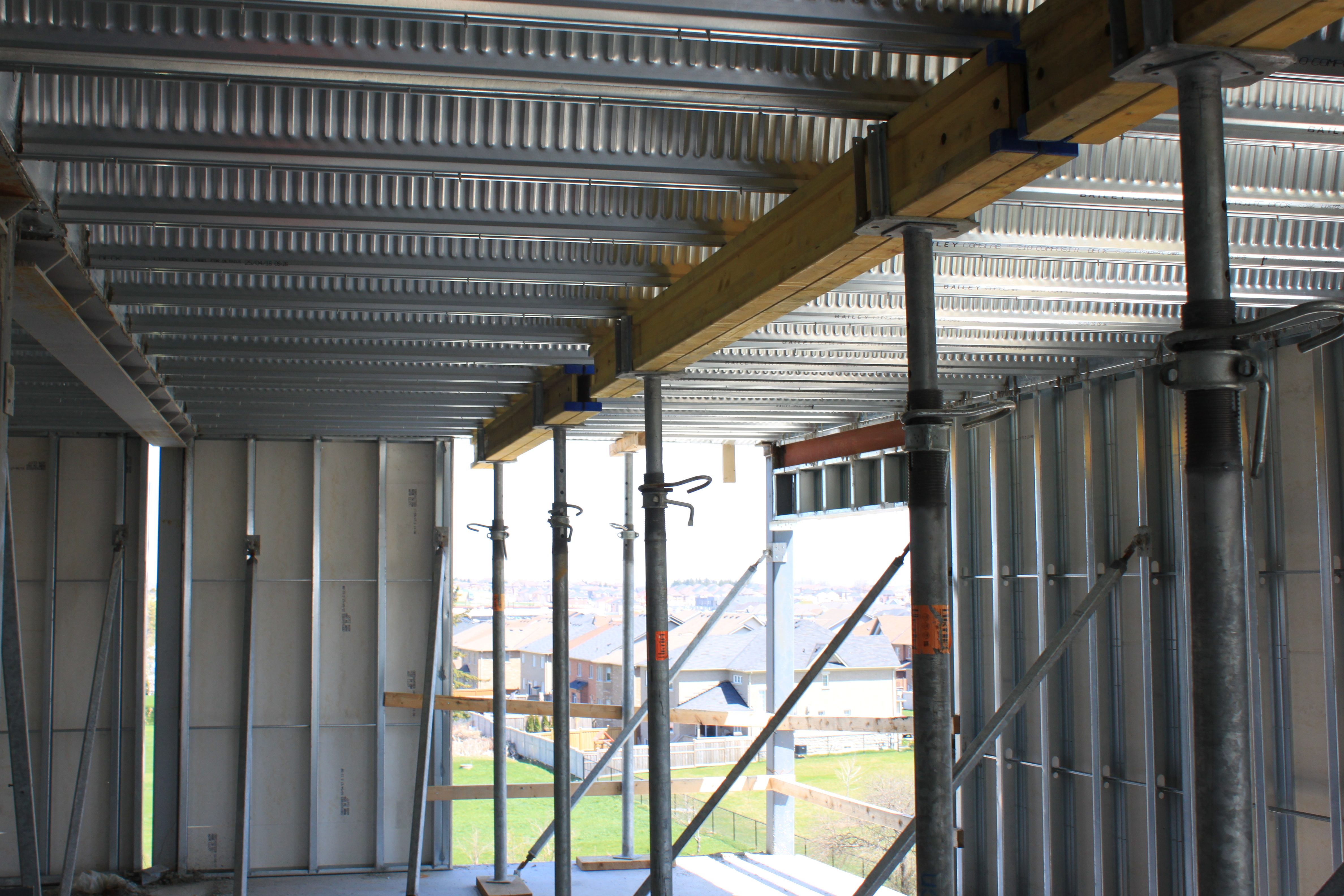 Inside of comslab deck with shoring and interior framing
